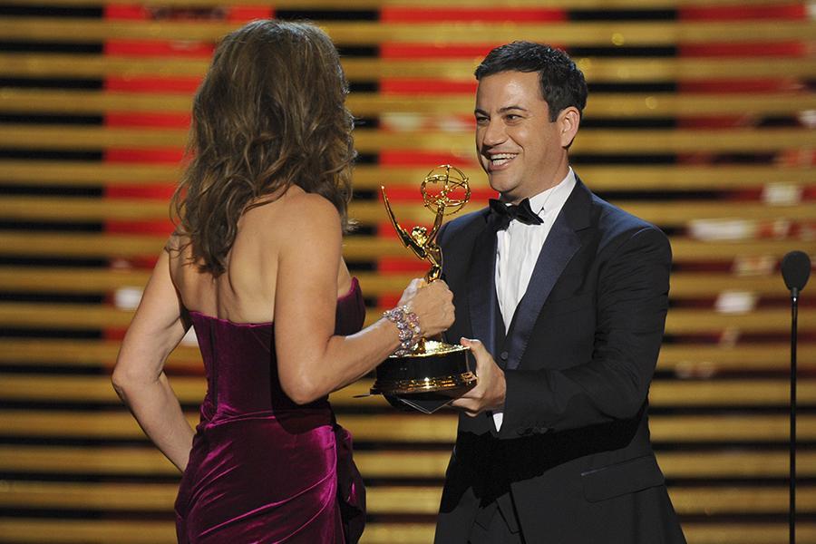 Jimmy Kimmel (r) presents an award to Allison Janney (l) of Mom.