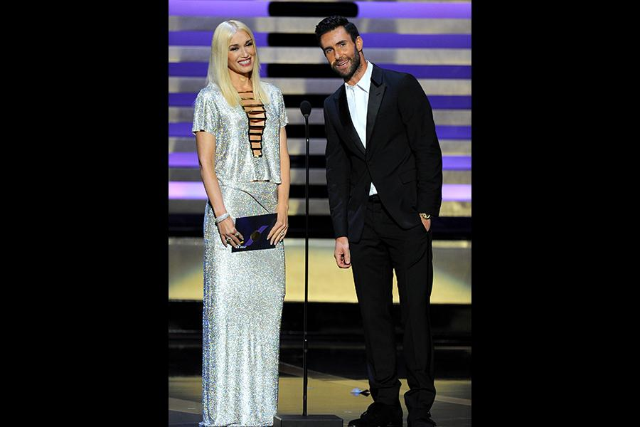 Gwen Stefani (l) and Adam Levine (r) of The Voice present an award at the 66th Emmys.
