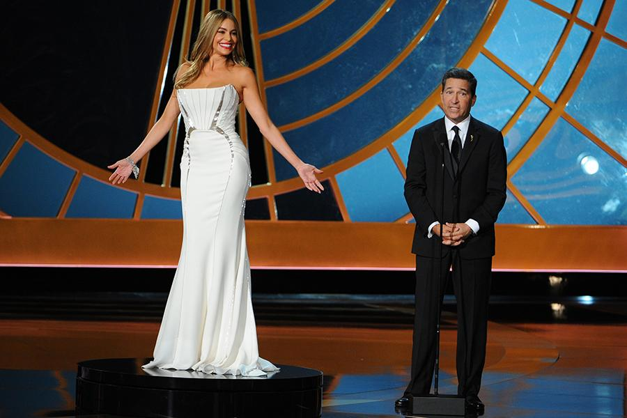 Sofia Vergara (l) of Modern Family and Television Academy CEO Bruce Rosenblum present an award at the 66th Emmy Awards.