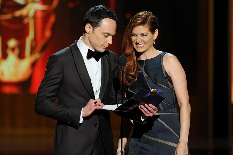 Jim Parsons of The Big Bang Theory and Debra Messing present an award at the 66th Emmys.