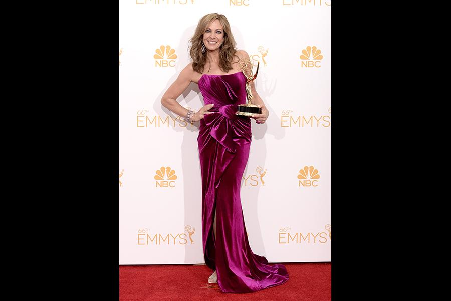 Allison Janney of Mom celebrates at the 66th Emmys.