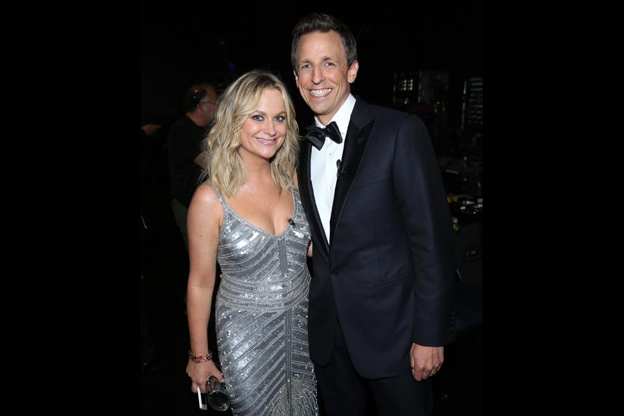 Amy Poehler (l) of Parks and Recreation and Seth Meyers (r) of Late Night With Seth Meyers backstage at the 66th Emmys.
