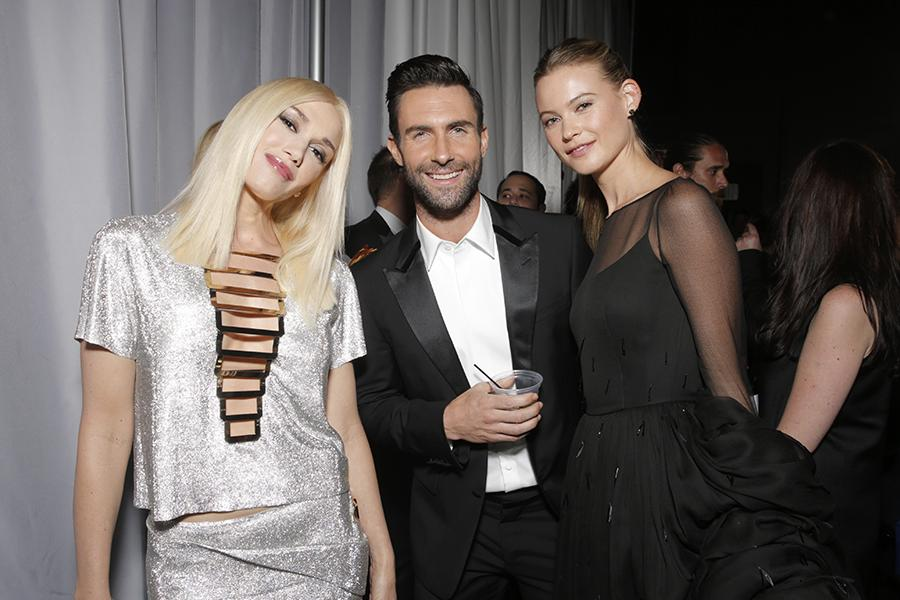 Gwen Stefani (l), Adam Levine (c), and Behati Prinsloo (r) at the 66th Emmy Awards.