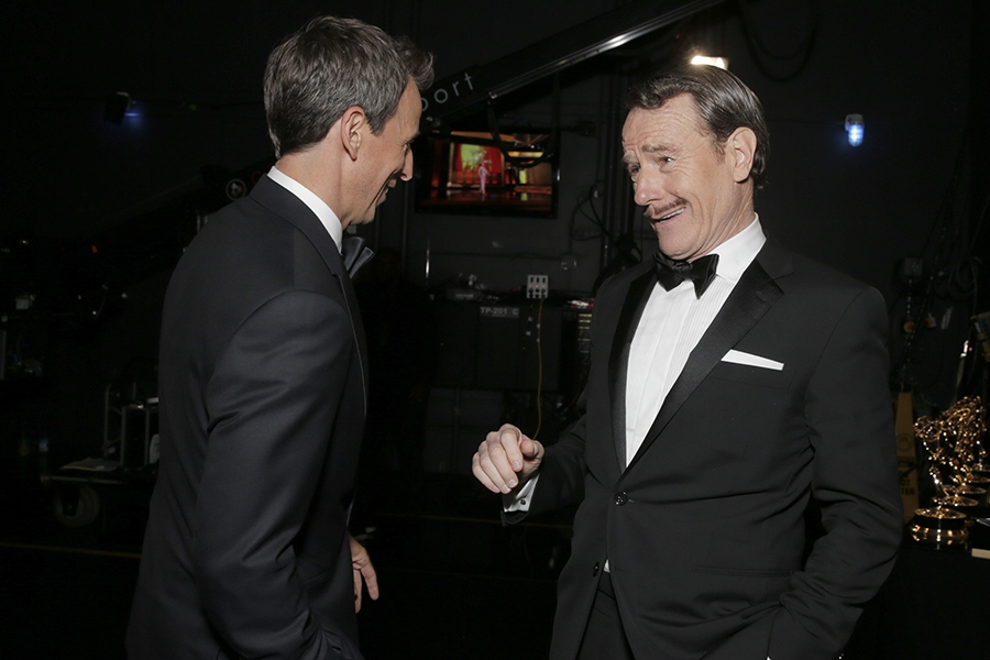 Seth Meyers (l) of Late Night with Seth Meyers and Bryan Cranston (r) of Breaking Bad at the 66th Emmy Awards.