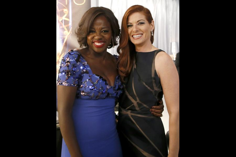 Viola Davis (l) and Debra Messing (r) at the 66th Emmys.