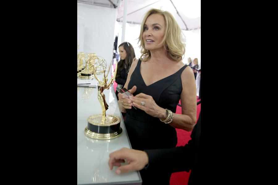 Jessica Lange of American Horror Story celebrates at the 66th Emmys.