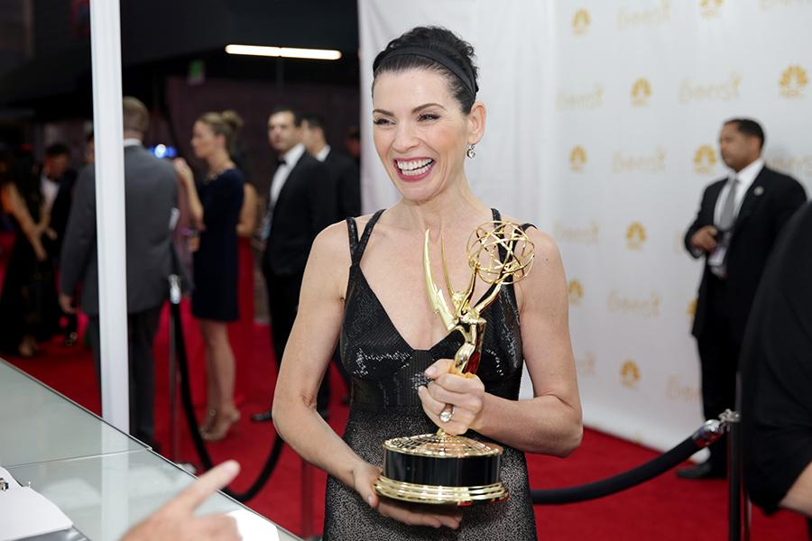 Julianna Margulies of The Good Wife celebrates at the 66th Emmys.