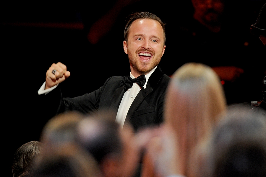 Aaron Paul of Breaking Bad celebrates at the 66th Emmys.