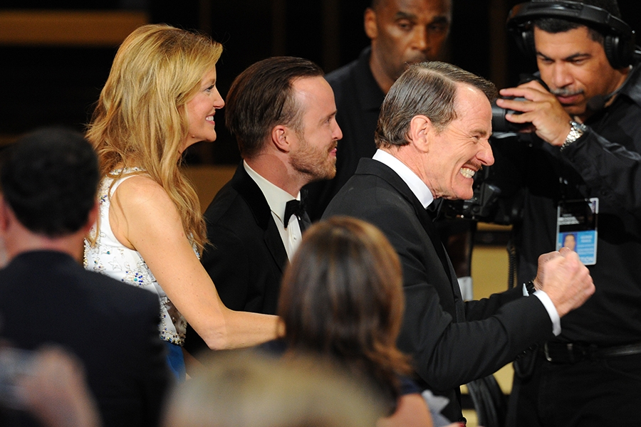 Anna Gunn, Aaron Paul (c) and Bryan Cranston (r) accept the award for outstanding drama series for their work on Breaking Bad at the 66th Emmys.