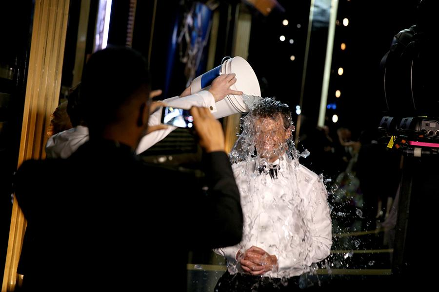 Seth Meyers of Late Night With Seth Meyers does the ALS ice bucket challenge backstage at the 66th Emmys.