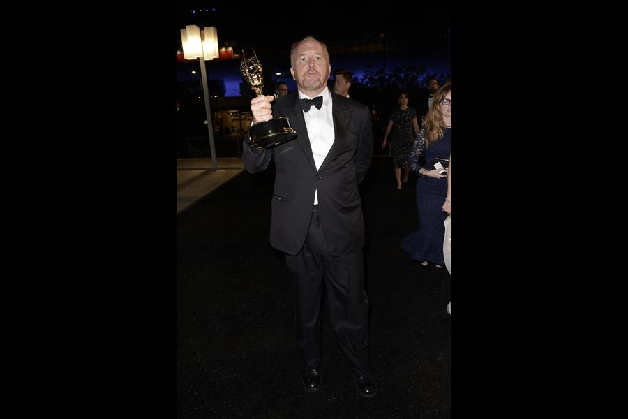 Louis CK of Louie celebrates his win at the 66th Emmys Governors Ball.