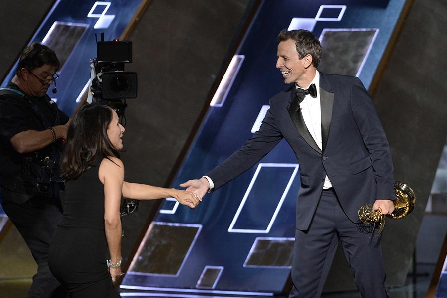 Seth Meyer presents Julia Louis-Dreyfus an award at the 67th Emmy Awards.
