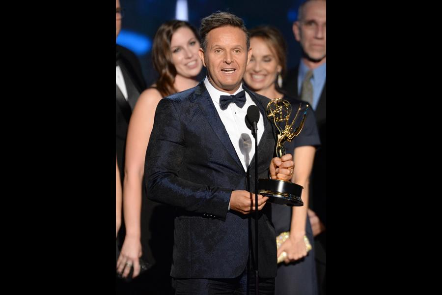 Mark Burnett accepts his award at the 67th Emmy Awards.