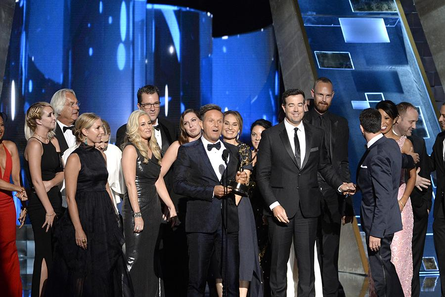 """Mark Burnett and the team from """"The Voice"""" accept an award at the 67th Emmy Awards."""