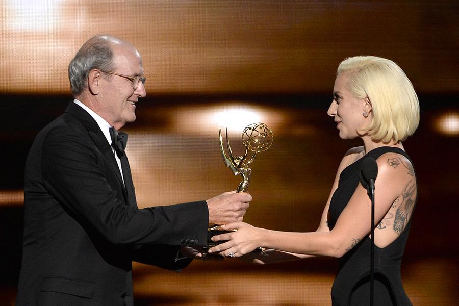 Richard Jenkins accepts his award from Lady Gaga at the 67th Emmy Awards.