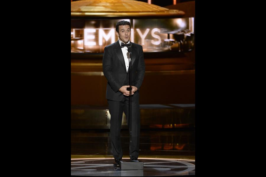 Fred Savage presents an award at the 67th Emmy Awards.