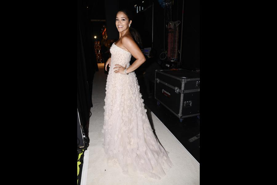 Gina Rodriguez backstage at the 67th Emmy Awards.