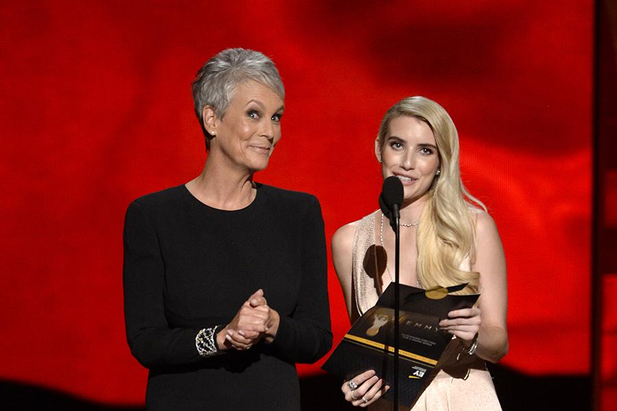 Jamie Lee Curtis and Emma Roberts present an award at the 67th Emmy Awards.