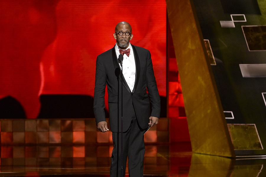 Reg E. Cathey presents the award at the 67th Emmy Awards.