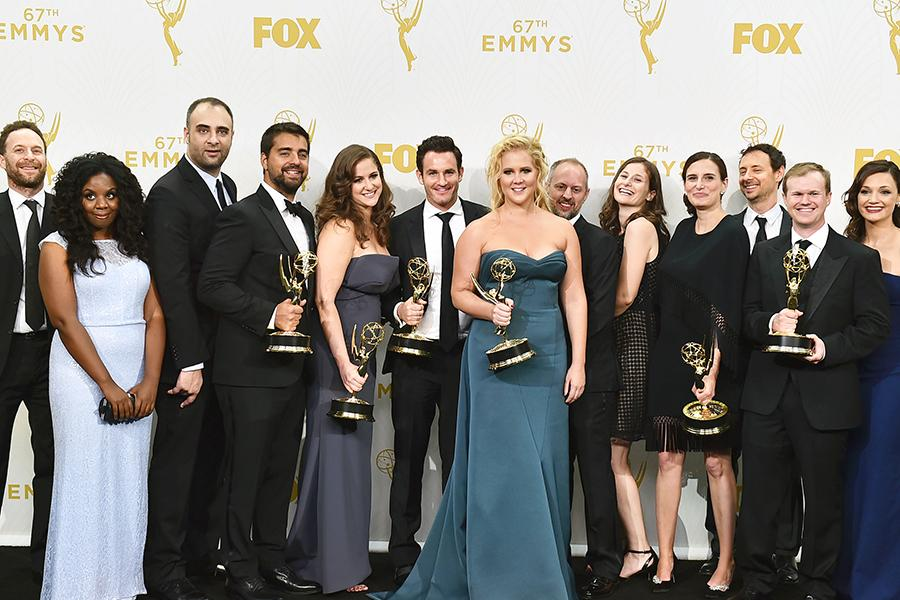 """Amy Schumer and the team from """"Inside Amy Schumer"""" backstage at the 67th Emmy Awards."""