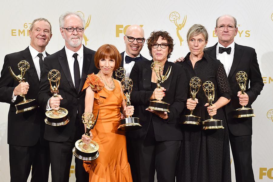 David Chatsworth, Gary Goetzman, Jane Anderson, Steven Shareshian, Lisa Cholodenko, Frances McDormand, and Richard Jenkins backstage at the 67th Emmy Awards.