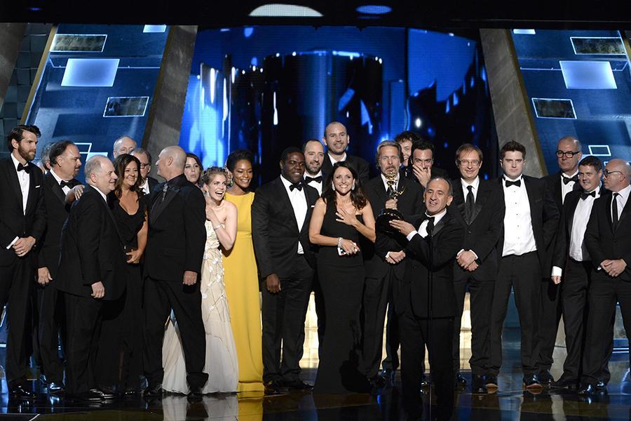 "Armando Iannucci and the team from ""Veep"" accept an award at the 67th Emmy Awards."
