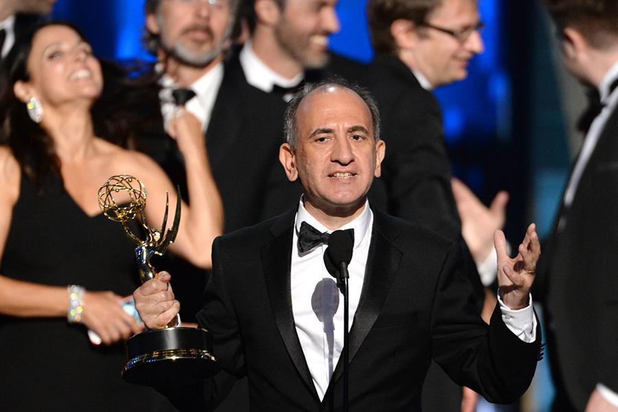 """Armando Iannucci and the team for """"Veep"""" accept their award at the 67th Emmy Awards."""