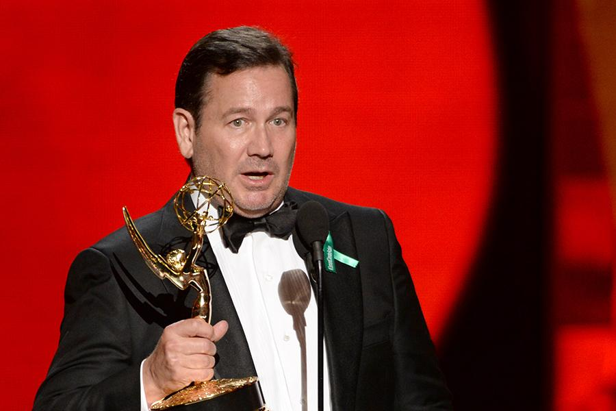 David Nutter accepts an award at the 67th Emmy Awards.