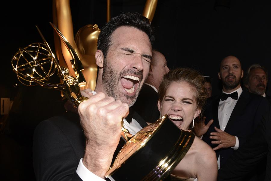 Reid Scott and Anna Chlumsky backstage at the 67th Emmy Awards.
