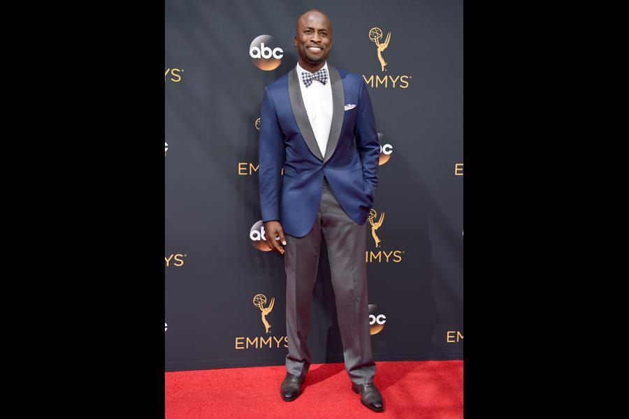 Akbar Gbaja-Biamila on the red carpet at the 2016 Primetime Emmys.