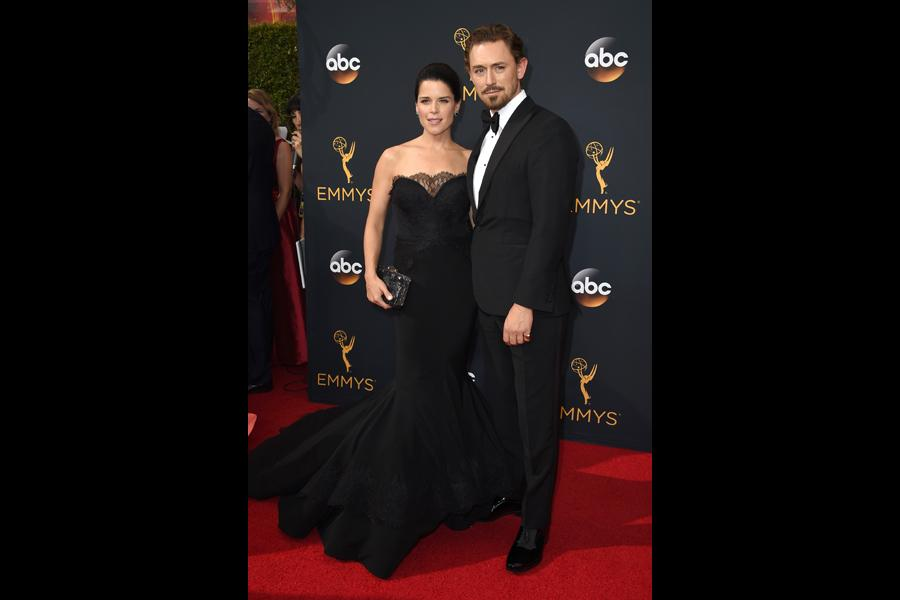 Neve Campbell and JJ Feild on the red carpet at the 2016 Primetime Emmys.