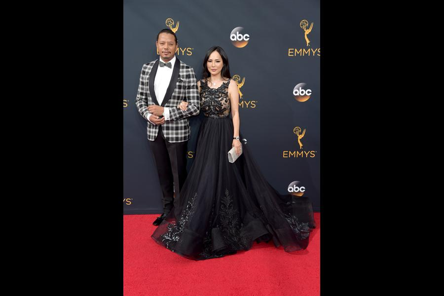 Terrence Howard and Miranda Pak on the red carpet at the 2016 Primetime Emmys.