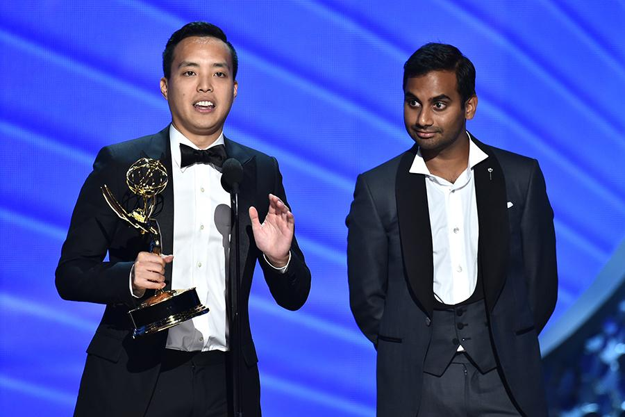 Kelvin Yu and Aziz Ansari accept their award at the 2016 Primetime Emmys.