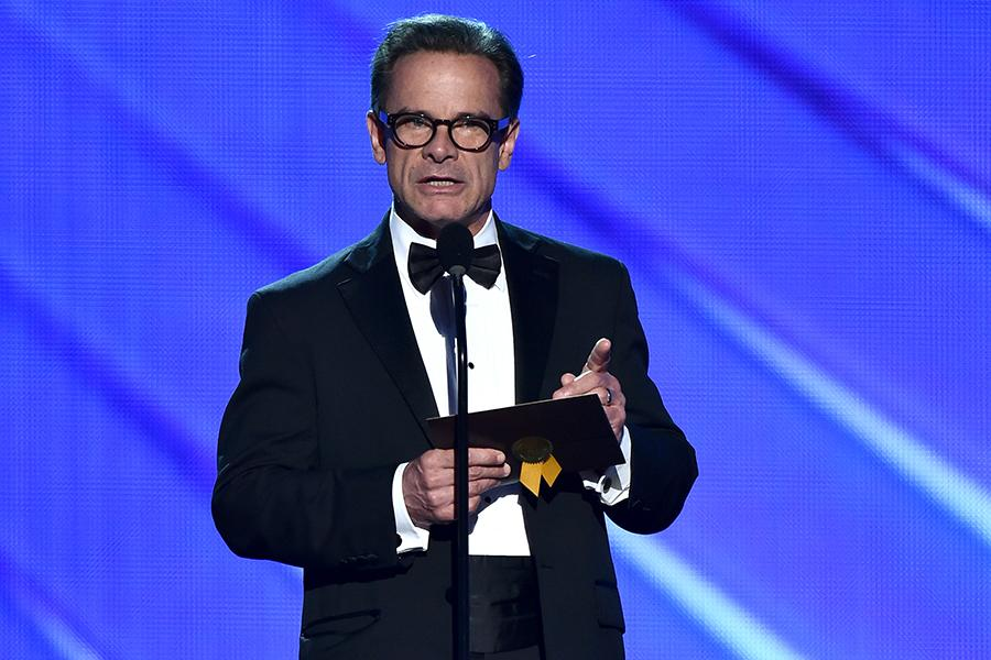 Peter Scolari presents an award at the 2016 Primetime Emmys.