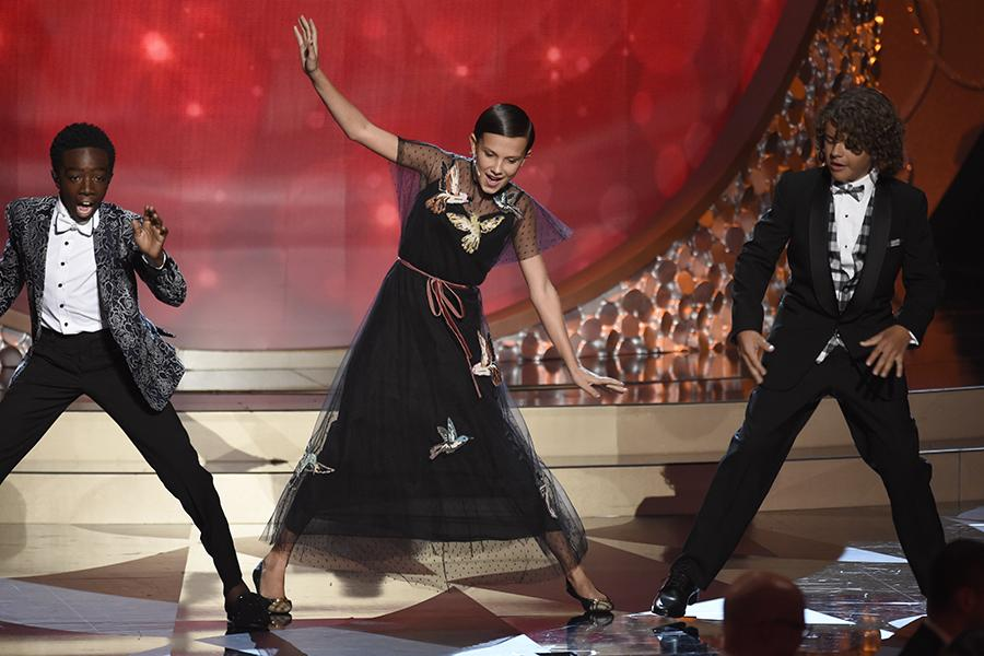 millie bobby brown and gaten matarazzo. caleb mclaughlin, millie bobby brown, and gaten matarazzo on stage at the 2016 primetime emmys. brown m