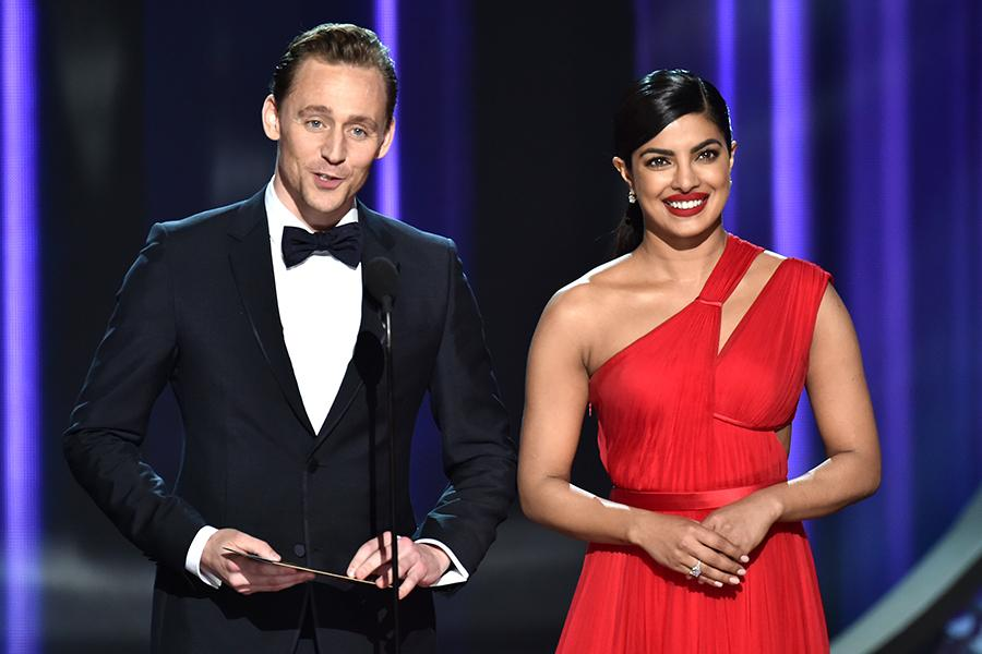 Tom Hiddleston and Priyanka Chopra present an award at the 2016 Primetime Emmys.