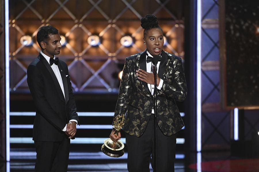 Aziz Ansari and Lena Waithe accept an award at the 2017 Primetime Emmys.