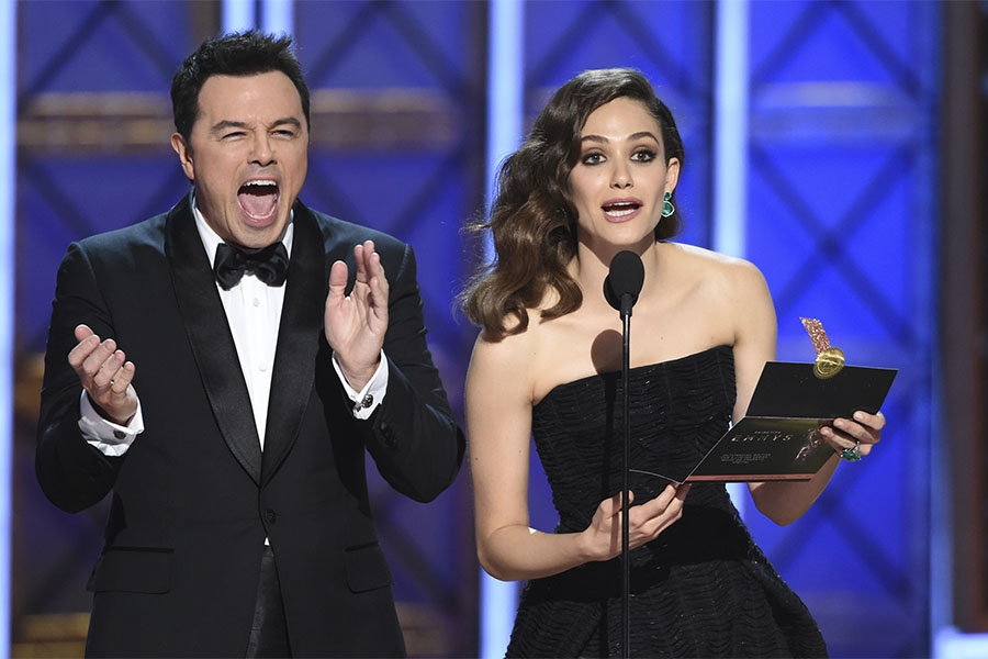 Seth MacFarlane and Emmy Rossum present an award at the 2017 Primetime Emmys.