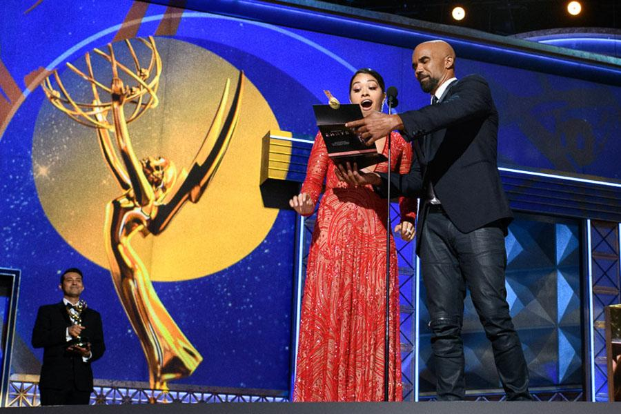Shamar Moore and Gina Rodriguez present an award at the 69th Primetime Emmys.