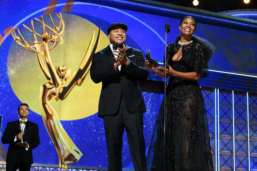 LL Cool J and Gabrielle Union present at the 69th Emmy Awards.