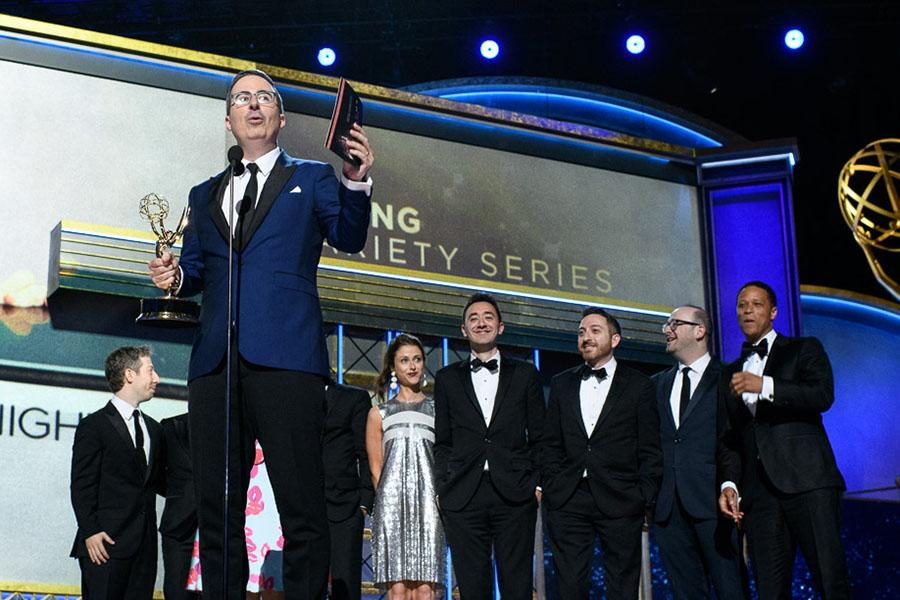 John Oliver and team accept an award at the 69th Emmy Awards.