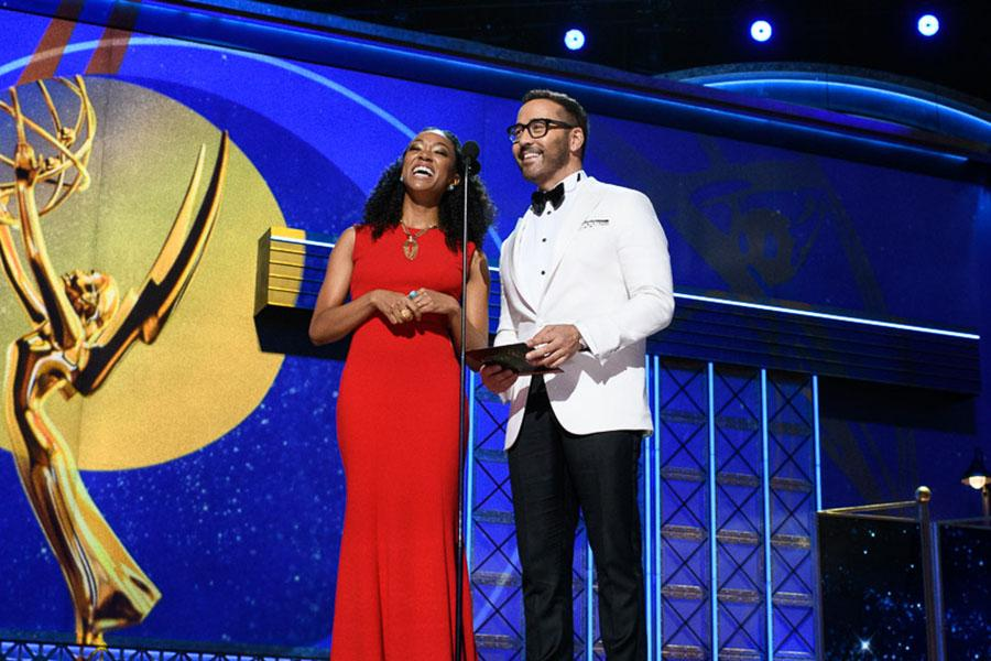 Sonequa Martin-Green and Jeremy Piven on stage at the 69th Emmy Awards.