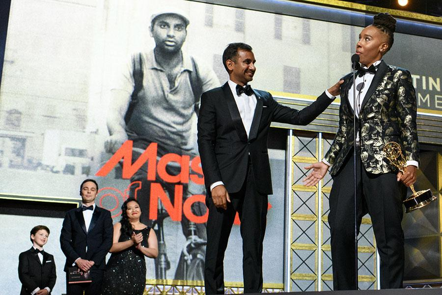 Aziz Ansari and Lena Waithe accept their award on stage at the 69th Primetime Emmys