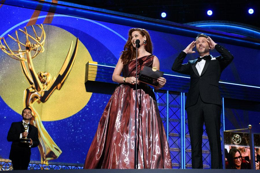 Debra Messing and Chris Hardwick on stage at the 69th Emmy Awards.