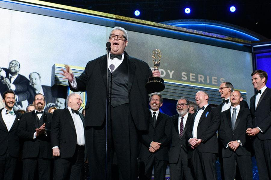 The Veep team accepts their award at the 69th Emmy Awards.