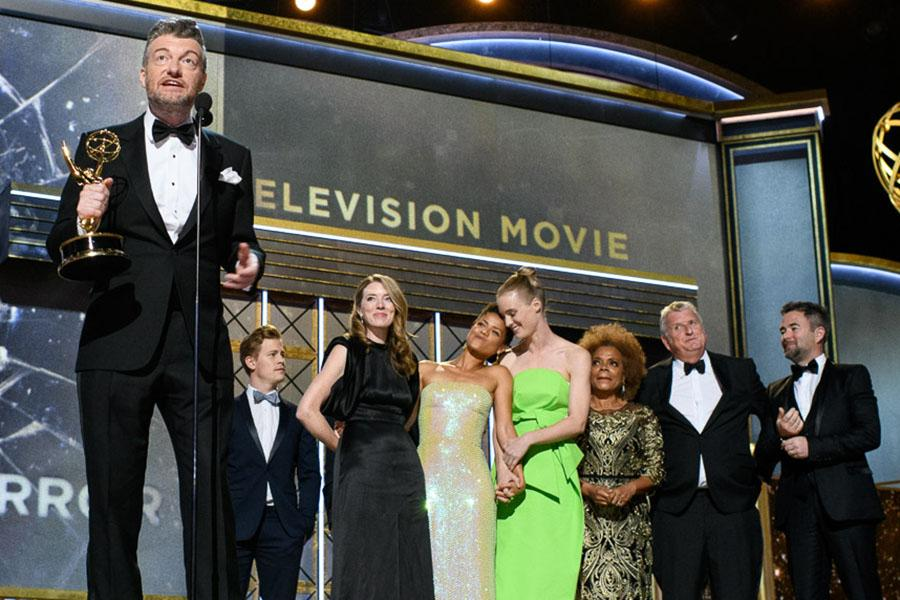 The Black Mirror team accepts an award at the 69th Emmy Awards.