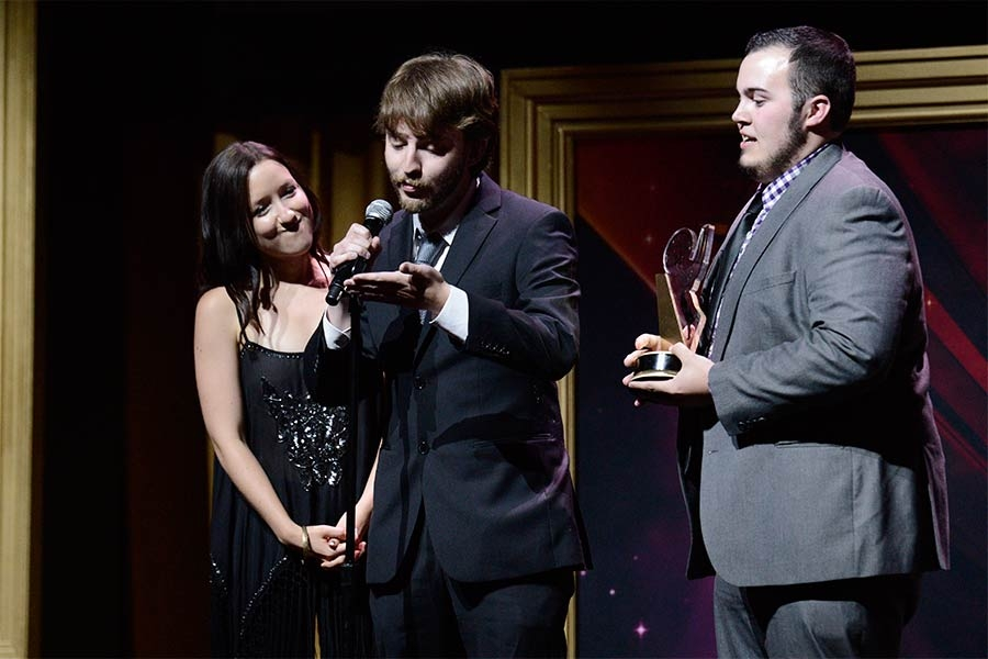 Tara Heaslip, Joseph Awgul, and Zach Ehrlich accept an award at the 36th College Television Awards at the Skirball Cultural Center in Los Angeles, California, April 23, 2015.