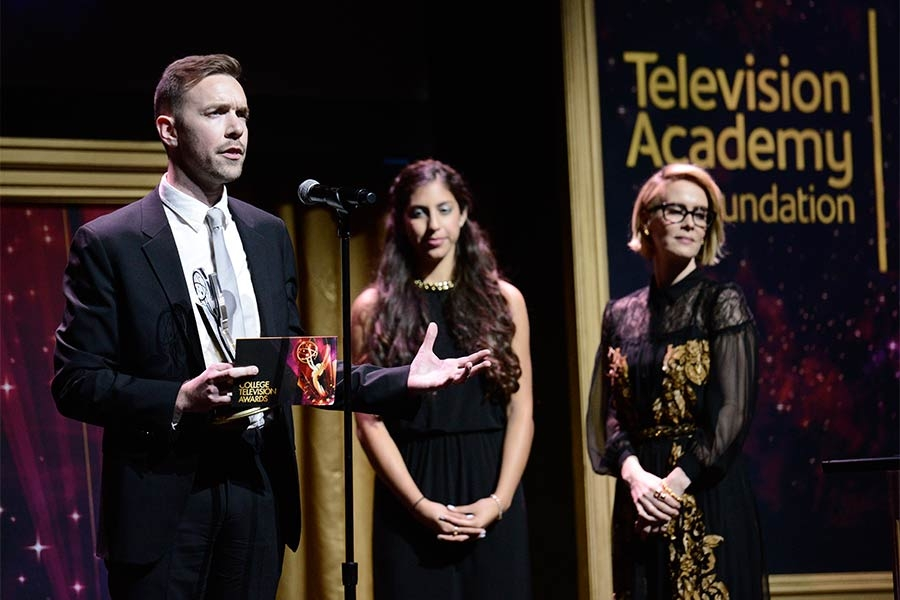 Henry Hughes accepts an award at the 36th College Television Awards at the Skirball Cultural Center in Los Angeles, California, April 23, 2015.