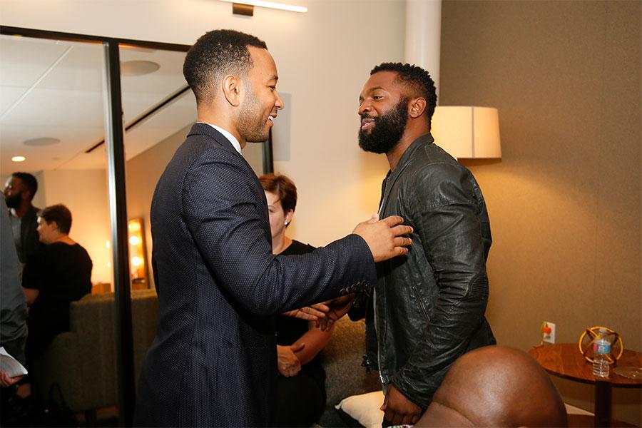 John Legend greets panel moderator Baratunde Thurston at Unlock Our Potential at the Television Academy's Saban Media Center, August 9, 2016.