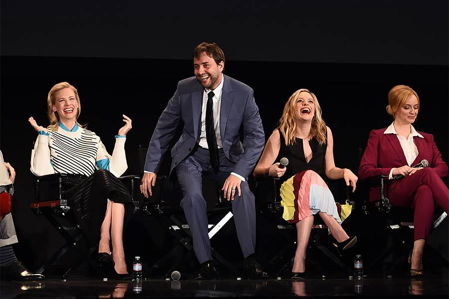 """Vincent Kartheiser entertains fellow cast members January Jones, Elisabeth Moss, and Christina Hendricks onstage at """"A Farewell to Mad Men,"""" May 17, 2015 at the Montalbán Theater in Hollywood, California."""
